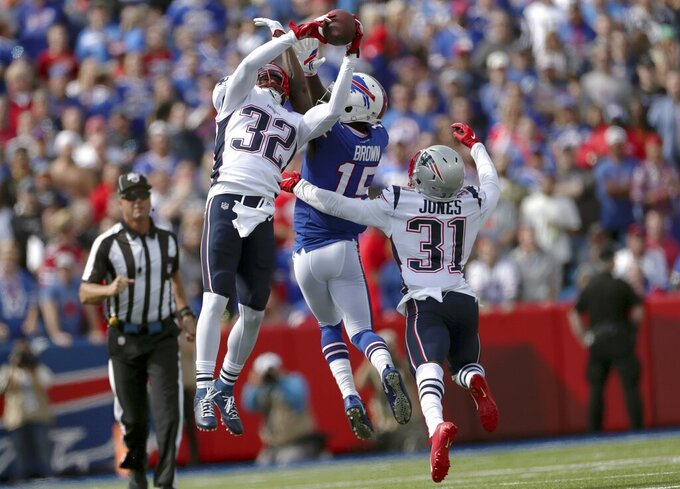 New England Patriots safety Devin McCourty (32) intercepts a pass intended for Buffalo Bills wide receiver John Brown (15) in the first half of an NFL football game, Sunday, Sept. 29, 2019, in Orchard Park, N.Y. (AP Photo/Ron Schwane)