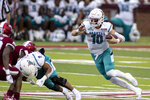 Coastal Carolina quarterback Grayson McCall (10) runs the ball against Troy during the first half of an NCAA college football game, Saturday, Dec. 12, 2020, in Troy, Ala. (AP Photo/Vasha Hunt)