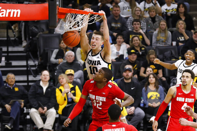 Iowa guard Joe Wieskamp (10) dunks the ball over Ohio State forward E.J. Liddell (32) during the second half of an NCAA college basketball game, Thursday, Feb. 20, 2020, in Iowa City, Iowa. Iowa won 85-76. (AP Photo/Charlie Neibergall)