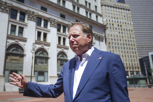 FILE - Geoffrey S. Berman arrives to his office in New York on Saturday, June 20, 2020. Berman, the ousted federal prosecutor in Manhattan who led several investigations into President Donald Trump's allies, has been hired by a law firm in New York.  Berman will provide criminal defense in white-collar cases and work on complex commercial litigation at Fried, Frank, Harris, Shriver & Jacobson, the firm announced Tuesday, Dec. 1, 2020. (AP Photo/Kevin Hagen, file)