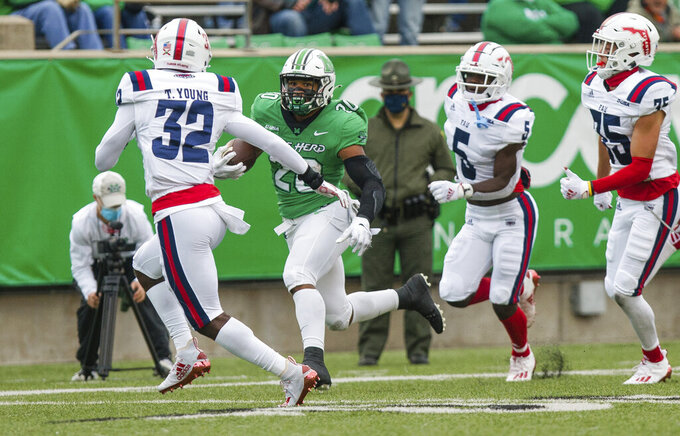 Marshall running back Brenden Knox (20) breaks up the sideline for a 58-yard receiving touchdown against Florida Atlantic during an NCAA college football game on Saturday, Oct. 24, 2020, at Joan C. Edwards Stadium Huntington, W.Va. (Sholten Singer/The Herald-Dispatch via AP)
