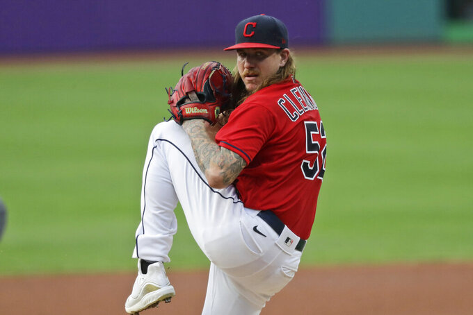 Cleveland Indians starting pitcher Mike Clevinger delivers in the first inning in a baseball game against the Minnesota Twins, Wednesday, Aug. 26, 2020, in Cleveland. (AP Photo/Tony Dejak)
