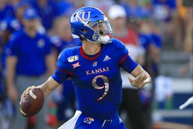Kansas quarterback Carter Stanley (9) passes to a teammate during the first half of an NCAA college football game against Coastal Carolina in Lawrence, Kan., Saturday, Sept. 7, 2019. (AP Photo/Orlin Wagner)