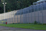 FILE - In this June 12, 2015, file photo, fencing surrounds the Hinds County Detention Center in Raymond, Miss. Mississippi's habitual offender laws are causing