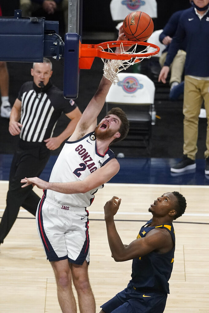 Gonzaga's Drew Timme (2) shoots over West Virginia's Oscar Tshiebwe (34) during the second half of an NCAA college basketball game, Wednesday, Dec. 2, 2020, in Indianapolis. (AP Photo/Darron Cummings)
