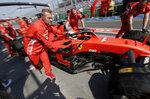 Pit crew for Ferrari driver Sebastian Vettel of Germany push his car in pit lane during the final practice session for the Australian Grand Prix in Melbourne, Australia, Saturday, March 16, 2019. The first race of the year is Sunday. (AP Photo/Rick Rycroft)