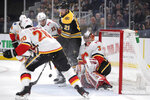 Boston Bruins left wing Nick Ritchie (21) tries to tip the puck past Calgary Flames goaltender David Rittich (33) during the second period of an NHL hockey game in Boston, Tuesday, Feb. 25, 2020. (AP Photo/Charles Krupa)