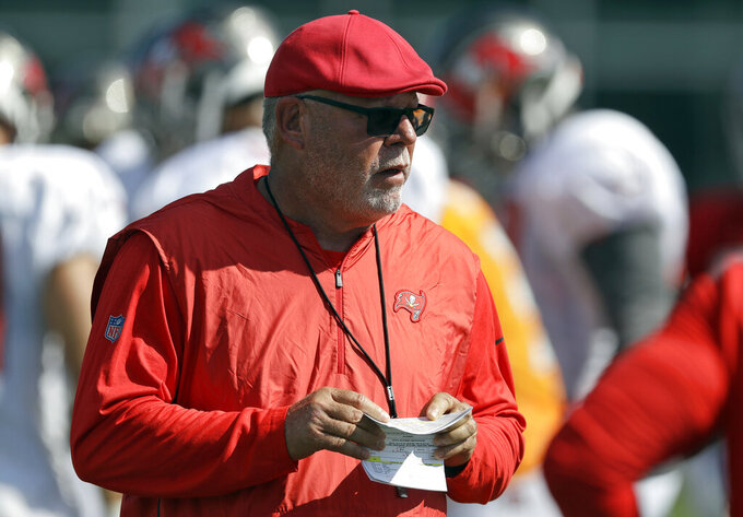 FILE - In this Tuesday, July 30, 2019 file photo, Tampa Bay Buccaneers head coach Bruce Arians calls a play during an NFL football training camp practice in Tampa, Fla. The Buccaneers make their preseason debut under Bruce Arians, the latest coach to take a crack at ending the team's long playoff drought on Friday, Aug. 9, 2019. (AP Photo/Chris O'Meara, File)