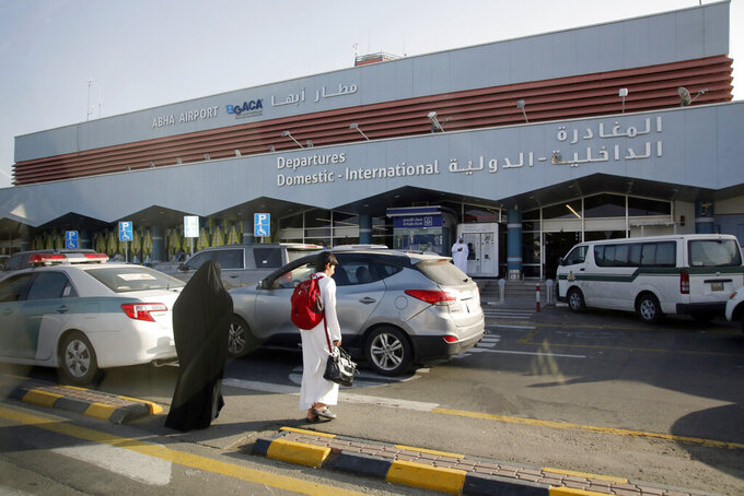 FILE - In this Aug. 22, 2019 file photo, Saudi passengers enter the departure terminal of Abha airport, in southwestern Saudi Arabia. A bomb-laden drone on Tuesday, Aug. 31, 2021 targeted Abha airport, wounding some eight people and damaging a civilian plane, Saudi state television reported, the latest assault on the kingdom amid its grinding war in neighboring Yemen. There was no immediate claim of responsibility for the attack, the second such strike on Abha airport in the last 24 hours. (AP Photo/Amr Nabil, File)
