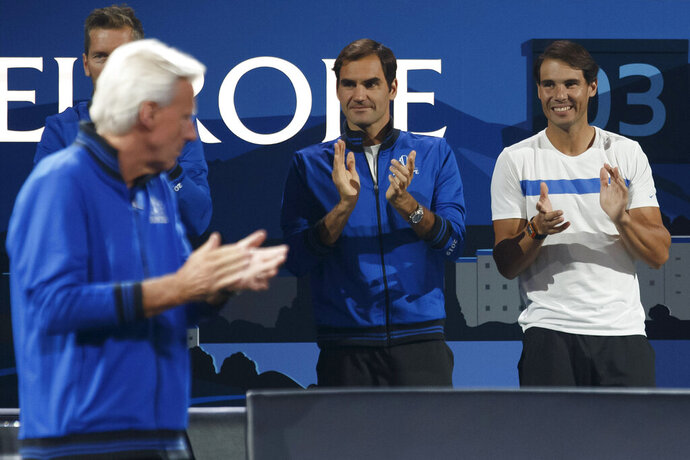 Team Europe's Captain, Bjorn Borg, left, with Team Europe's players Roger Federer, center, and Rafael Nadal, right, applaude at the Laver Cup tennis event in Geneva, Switzerland, Saturday, Sept. 21, 2019. (Salvatore Di Nolfi/Keystone via AP)