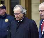 FILE - In this Jan. 14, 2009 file photo, Bernie Madoff leaves Federal Court in New York.  Madoff, the financier who pleaded guilty to orchestrating the largest Ponzi scheme in history, died early Wednesday, April 14, 2021,  in a federal prison, a person familiar with the matter told The Associated Press. ( AP Photo/Stuart Ramson, File