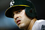 FILE - In this Sept. 12, 2018, file photo, Oakland Athletics' Ramon Laureano prepares for an at-bat during a baseball game against the Baltimore Orioles in Baltimore. Laser-armed rookie Ramon Laureano emerged as Oakland's center fielder for the final two months and batted .288 with five homers and 19 RBIs with seven stolen bases in 45 games. (AP Photo/Patrick Semansky, File)