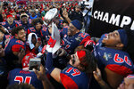 Fresno State players celebrate with the trophy after defeating Arizona State in the Las Vegas Bowl NCAA college football game, Saturday, Dec. 15, 2018, in Las Vegas. Fresno State won 31-20. (AP Photo/John Locher)