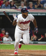 Cleveland Indians' Yasiel Puig watches his three-run double off of Philadelphia Phillies relief pitcher Cole Irvin during the seventh inning of a baseball game in Cleveland, Sunday, Sept. 22, 2019. (AP Photo/Phil Long)