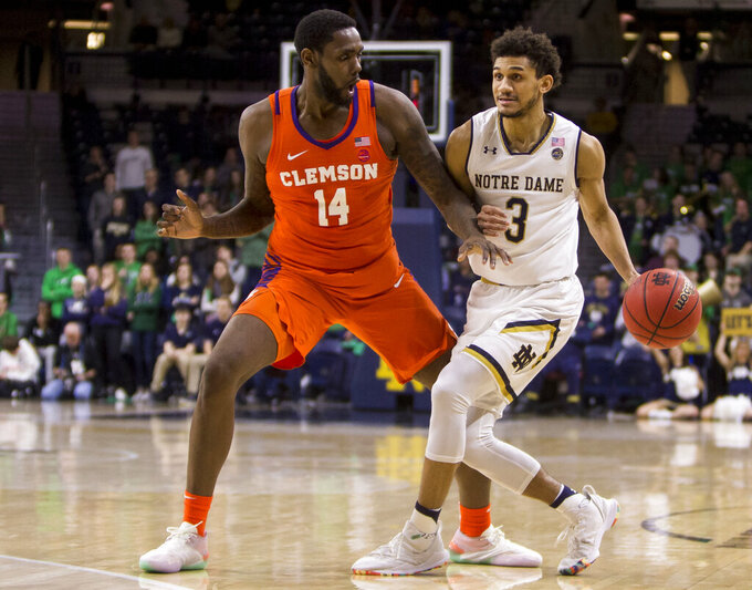 Notre Dame's Prentiss Hubb (3) tries to move by Clemson's Elijah Thomas (14) during the second half of an NCAA college basketball game Wednesday, March 6, 2019, in South Bend, Ind. Clemson won 64-62. (AP Photo/Robert Franklin)