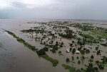 This photo issued Tuesday March 19, 2019, taken within last week and supplied by World Food Programme,  flood waters cover large tracts of land in Nicoadala, Zambezia Province of Mozambique. Rapidly rising floodwaters have created