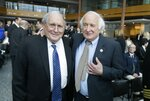 FILE - In this April 11, 2016 file photo, former U.S. Sen. Carl Levin, left, stands with his brother, Congressman Sander Levin before an unveiling of the USS Carl M. Levin during a ceremony in Detroit.  Former Sen. Carl Levin, a powerful voice for the military during his career as Michigan's longest-serving U.S. senator, has died. The Democrat was 87. Levin's family says Levin died Thursday, July 29, 2021.(AP Photo/Carlos Osorio File)