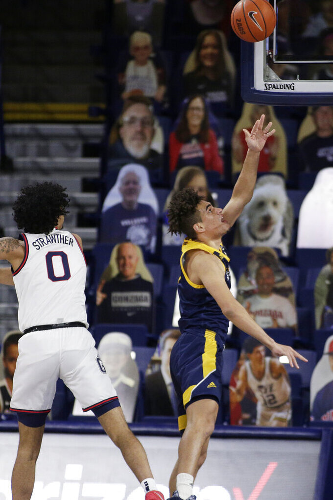 Northern Arizona guard Jay Green, right, shoots next to Gonzaga guard Julian Strawther during the second half of an NCAA college basketball game in Spokane, Wash., Monday, Dec. 28, 2020. Gonzaga won 88-58. (AP Photo/Young Kwak)