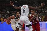 Poland's A.J. Slaughter attempts to get past United States' Harrison Barnes and United States' Derrick White at left during a consolation playoff game for the FIBA Basketball World Cup at the Cadillac Arena in Beijing on Saturday, Sept. 14, 2019. U.S. defeated Poland 87-74 (AP Photo/Ng Han Guan)