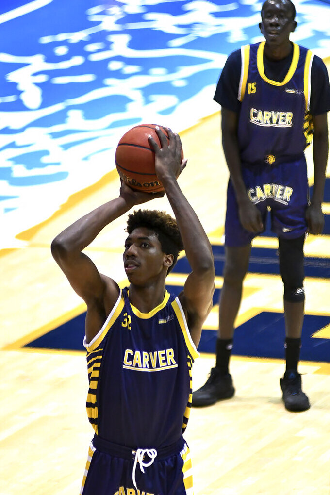 Carver College forward Robert Doubose shots a free throw during the second half of an NCAA college basketball game against Florida International Monday, Dec. 21, 2020, in Miami. (AP Photo/Gaston De Cardenas)