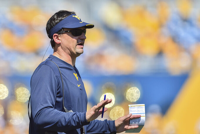 West Virginia head coach Neal Brown reacts during the first half of an NCAA college football game against Virginia Tech in Morgantown, W.Va., Saturday, Sept. 18, 2021. (AP Photo/William Wotring)