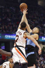 Cleveland Cavaliers' Dante Exum (1) shoots over Los Angeles Clippers' Amir Coffey (7) in the first half of an NBA basketball game, Sunday, Feb. 9, 2020, in Cleveland. (AP Photo/Tony Dejak)