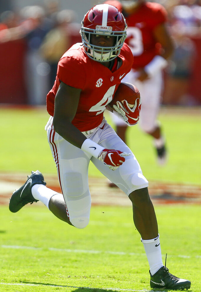 FILE - In this Sept. 29, 2018, file photo, Alabama wide receiver Jerry Jeudy (4) carries the ball after a reception during the first half of an NCAA college football game against Louisiana-Lafayette, in Tuscaloosa, Ala. No. 1 Alabama has one of the SEC's most talented collection of receivers, and the Crimson Tide is spreading it around among Jerry Jeudy, Henry Ruggs III, DeVonta Smith and Jaylen Waddle.(AP Photo/Butch Dill, File)