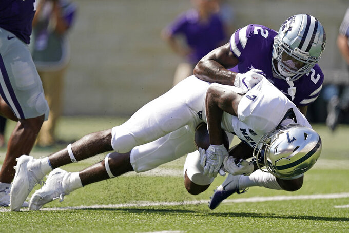 = during the first half of an NCAA college football game against Saturday, Sept. 18, 2021, in Manhattan, Kan. (AP Photo/Charlie Riedel)