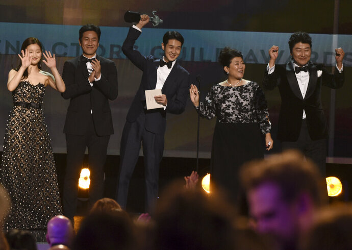 Park So-dam, from left, Lee Sun Gyun, Choi Woo-shik, Lee Jeong-eun and Kang-Ho Song accept the award for outstanding performance by a cast in a motion picture for