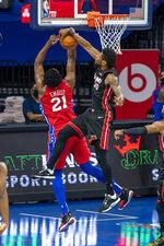 Miami Heat's Chris Silva, right, blocks the shot by Philadelphia 76ers' Joel Embiid, left, during the first half of an NBA basketball game, Thursday, Jan. 14, 2021, in Philadelphia. (AP Photo/Chris Szagola)