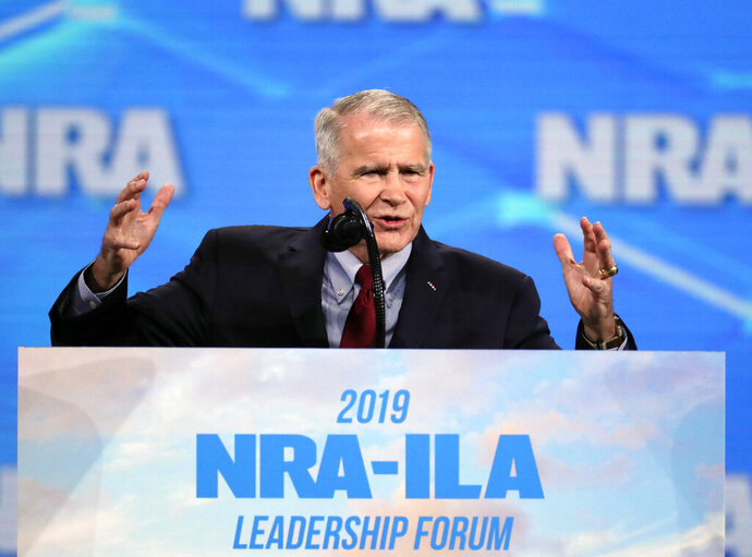 FILE - In this Friday, April 26, 2019, file photo, National Rifle Association President Col. Oliver North speaks at the National Rifle Association Institute for Legislative Action Leadership Forum in Lucas Oil Stadium in Indianapolis. Former NRA President North says in court filings that he was thwarted at every step as he tried to raise alarm bells about alleged misspending at the gun lobbying group. He denied that he had tried to stage a coup to oust NRA's longtime top executive. (AP Photo/Michael Conroy, File)