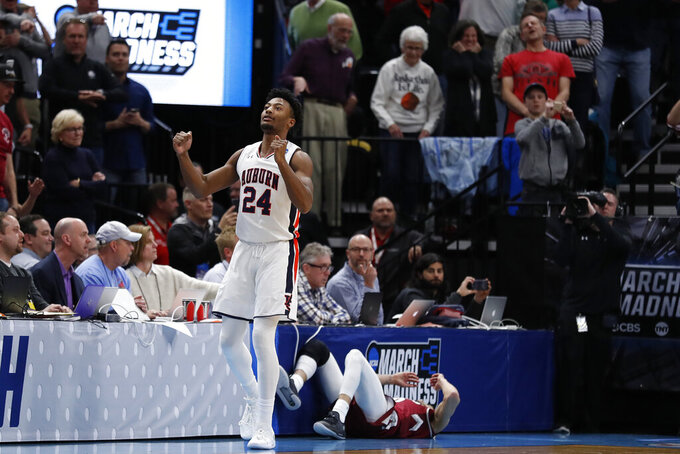 Auburn forward Anfernee McLemore (24) reacts to winning their first round men's college basketball game against the New Mexico State in the NCAA Tournament Thursday, March 21, 2019, in Salt Lake City. (AP Photo/Jeff Swinger)