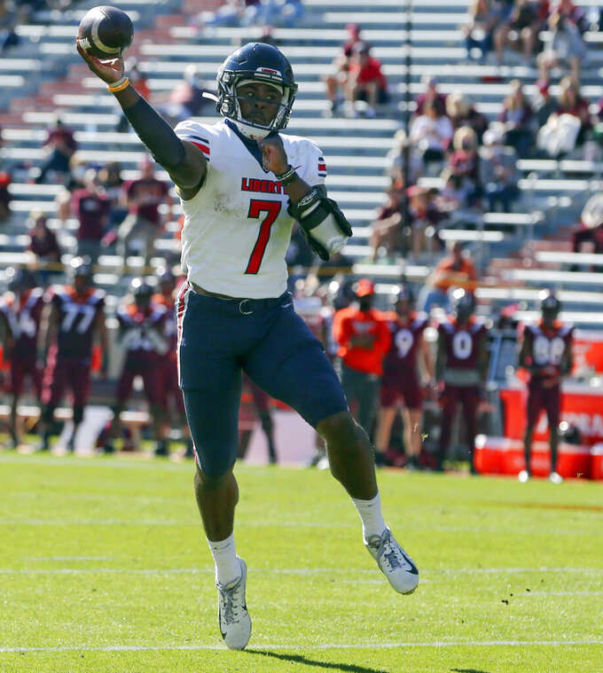 Liberty quarterback Malik Willis throws a touchdown pass during the first half of an NCAA college football game against Virginia Tech, Saturday, Nov. 7 2020, in Blacksburg, Va. (Matt Gentry/The Roanoke Times via AP, Pool)