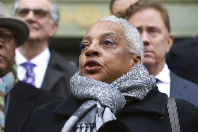 Elizabeth Horton Sheff, mother of Milo Sheff, speaks outside the Connecticut Supreme Court on the new agreements reached in the long-running Sheff v. O'Neill school desegregation case, Friday, Jan. 10, 2020, in Hartford, Conn. The court ruled in 1996 that extreme racial segregation between Hartford schools and suburban schools violated the state constitution. The settlement includes new measures to reach diversity goals and allows for judicial oversight to end once they are shown to produce opportunities in diverse school settings for all Hartford families. (AP Photo/Chris Ehrmann)