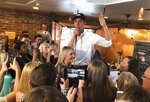 Former Texas Rep. Beto O'Rourke dons a Nevada Wolf Pack hat as speaks about his campaign for the 2020 Democratic presidential nomination to a packed coffee house on the edge of the Univeristy of Nevada campus in Reno, Nev., Thursday, April 25, 2019. (AP Photo/By Scott Sonner)