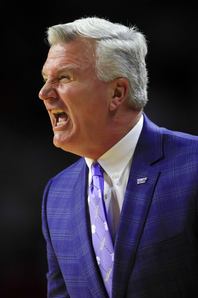 Kansas State coach Bruce Weber yells to his team during the first half of an NCAA college basketball game against Marquette in Manhattan, Kan., Saturday, Dec. 7, 2019. (AP Photo/Orlin Wagner)