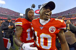 Kansas City Chiefs' Mecole Hardman (17) and Tyreek Hill (10) celebrate after the NFL AFC Championship football game against the Tennessee Titans Sunday, Jan. 19, 2020, in Kansas City, MO. The Chiefs won 35-24 to advance to Super Bowl 54. (AP Photo/Ed Zurga)