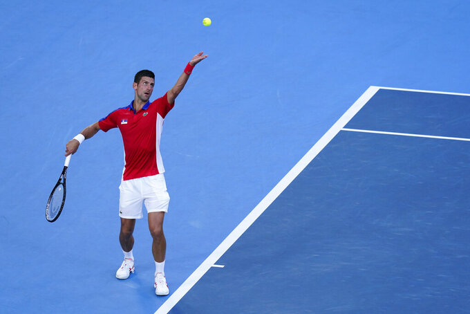 Novak Djokovic, of Serbia, serves to Alejandro Davidovich Fokina, of Spain, during the third round of the men's tennis competition at the 2020 Summer Olympics, Wednesday, July 28, 2021, in Tokyo, Japan. (AP Photo/Patrick Semansky)