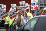 Shipbuilders picket outside an entrance to Bath Iron Works, Monday, June 22, 2020, in Bath, Maine. Thousands of workers went on strike against one of the Navy's largest shipbuilders Monday after rejecting a three-year contract.   (AP Photo/Robert F. Bukaty)