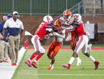 Syracuse wide receiver Sean Riley carries the ball before being tackled by Liberty cornerback Emanuel Dabney with Syracuse wide receiver Taj Harris and Liberty's Mikel Jones in tow during the second half of an NCAA college football game in Lynchburg, Va. Saturday, Aug. 31, 2019. (AP Photo/Matt Bell)