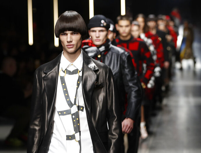 Models wear creations as part of the Versace men's Fall-Winter 2019-20 collection, that was presented in Milan, Italy, Saturday, Jan.12, 2019. (AP Photo/Antonio Calanni)