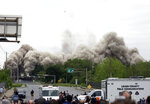 Dust and debris fill the air as Martin Tower, former world headquarters of Bethlehem Steel, implodes Sunday, May 19, 2019, in Bethlehem, Pa. Crowds gathered to watch the demolition of the area's tallest building, a 21-story monolith that opened at the height of Bethlehem Steel's power and profitability but had stood vacant for a dozen years after America's second-largest steelmaker went out of business. (AP Photo/Jacqueline Larma)