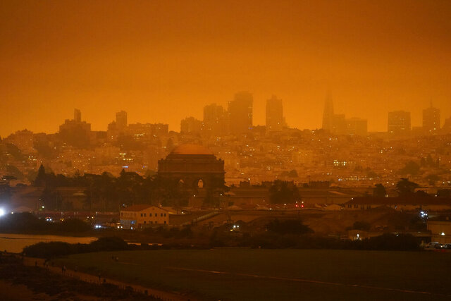 FILE - In this Sept. 9, 2020, file photo, the San Francisco skyline in the distance behind Crissy Field is barely visible due to smoke from wildfires burning across California. Researchers say smoke from wildfires accounted for up to half of all small particle air pollution in parts of the western U.S. in recent years (AP Photo/Eric Risberg, File)