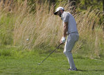 Dustin Johnson hits out of the rough on the seventh hole during a practice round for the PGA Championship golf tournament, Wednesday, May 15, 2019, at Bethpage Black in Farmingdale, N.Y. (AP Photo/Julio Cortez)