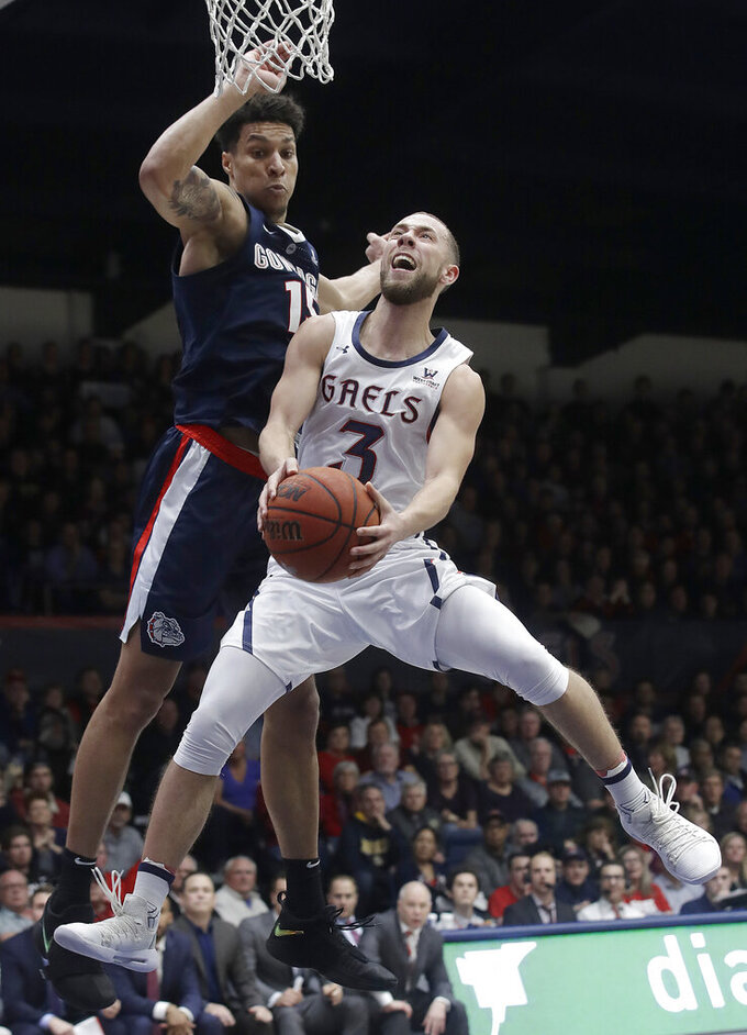 Saint Mary's guard Jordan Ford (3) shoots in front of Gonzaga forward Brandon Clarke during the second half of an NCAA college basketball game in Moraga, Calif., Saturday, March 2, 2019. (AP Photo/Jeff Chiu)