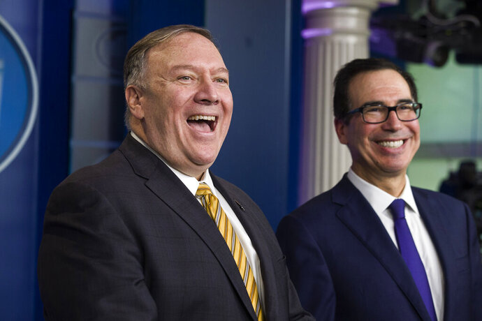 Secretary of State Mike Pompeo and Treasury Secretary Steve Mnuchin laugh as they speak with reporters in the briefing room of the White House during a briefing on terrorism financing Tuesday, Sept. 10, 2019, in Washington. (AP Photo/Alex Brandon)
