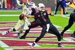 Arizona Cardinals quarterback Kyler Murray (1) throws as Los Angeles Rams defensive end Aaron Donald (99) puruses during the first half of an NFL football game, Sunday, Dec. 6, 2020, in Glendale, Ariz. (AP Photo/Rick Scuteri)