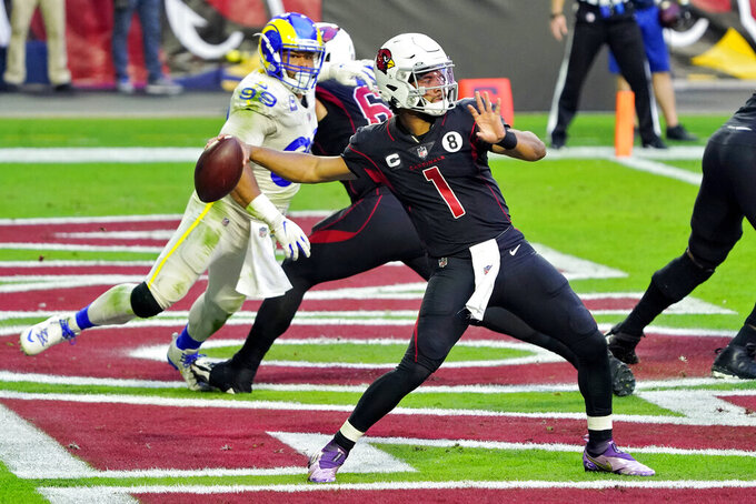 Arizona Cardinals quarterback Kyler Murray (1) throws as Los Angeles Rams defensive end Aaron Donald (99) puruses during the first half of an NFL football game, Sunday, Dec. 6, 2020, in Glendale, Ariz. (AP Photo/Rick Scuteri)