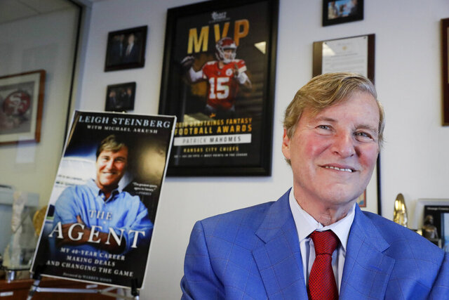 Sports agent Leigh Steinberg poses for a picture at his office Thursday, Feb. 13, 2020, in Newport Beach, Calif. A decade after his personal and professional life bottomed out, Steinberg has another Super Bowl MVP client, saw another former client be elected to the Pro Football Hall of Fame and could have yet another first-round draft pick in the spring. (AP Photo/Chris Carlson)