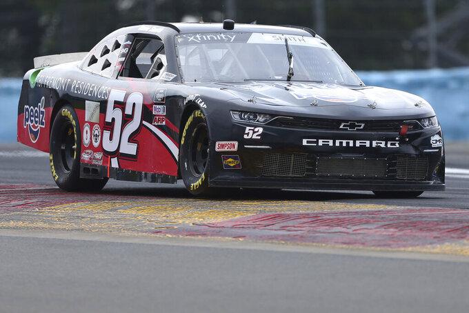 David Smith drives between Turn 1 and the Esses in the NASCAR Xfinity Series auto race at Watkins Glen International in Watkins Glen, N.Y., on Saturday, Aug. 7, 2021. (AP Photo/Joshua Bessex)